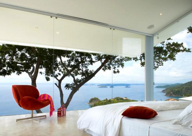glass-paneled-walls-modern-house-665x471